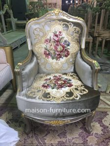 Louis XV armchair with carved silver gold wood finish and silver floral pattern silk fabric